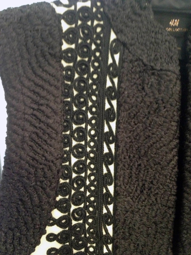 Close-up of weaving details on the vest